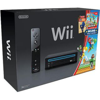 Nintendo Wii Gaming System with New Super Mario Bros. and a Mario Mu