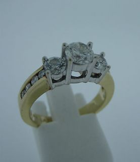 Gold 3 Stone Diamond Ring with .65 carat Brilliant Cut Center Stone