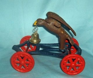 Cast Iron Old Free Wheeling Eagle with Bell on Cart 8 x 4 1/2 x 6