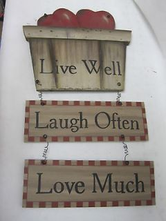 Wooden Plaque Decor reads Live well, laugh often, love much