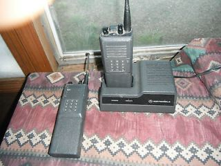 PAIR OF MOTOROLA HANDIE TALKIE​s.with CHARGER, WORKS GREAT!!