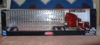 PETERBILT MODEL 379 CATTLE LIVESTOCK HAULER TRAILER 1:32 New Ray