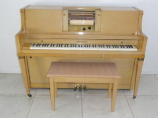 upright player piano in Piano