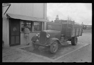 Crates of sweet potatoes being weighed at starch plant,Laurel,M