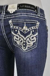 LA Idol Skinny Jeans With A Fabric Design And Rhinestone Buttons.