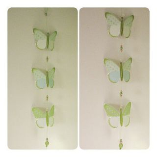 made butterfly chain mobile Paper and glass beads. Decor baby nursery