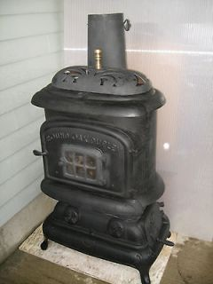 ANTIQUE ROUND OAK WOOD STOVE Duplex #24 08 A2 stove openings