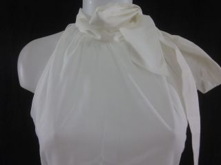 you are bidding on an alara white sleeveless tie neck cotton blouse