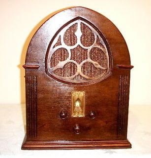 Antique General Motors vintage tube radio in cathedral cabinet