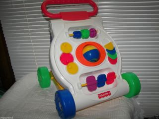 FISHER PRICE BABY DEVELOPMENT TOY # K9875 ACTIVITY WALKER PUSH TOY