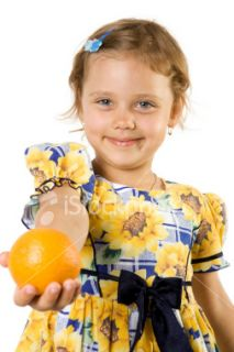 Little girl with orange. Royalty Free Stock Photo