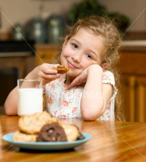 Little Girl Eating Cookies and Milk Royalty Free Stock Photo