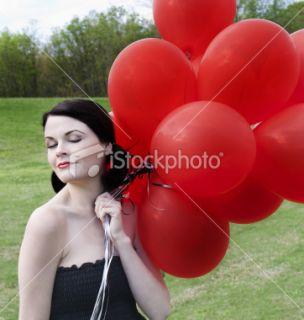 stock photo 19799668 happy girl holding balloons