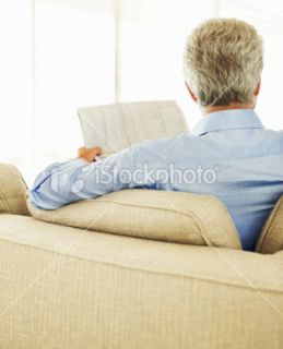 Rear view of a businessman reading newspaper Royalty Free Stock Photo