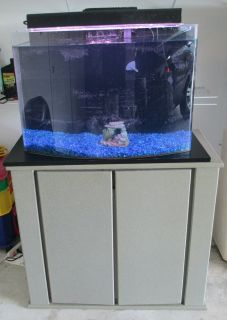 75 Gallon Bow Front Aquarium http://www.popscreen.com/p/MTU3MTYzMDk1/75-Gal-Bowfront-Aquarium-Black-Wood-Stand-Complete-Local-Pick-Up-Only-