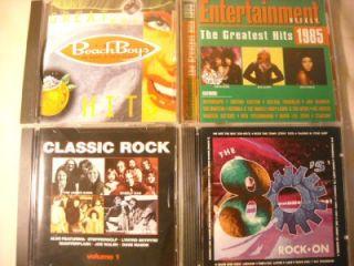 11) CDs GARTH, BILLY JOEL, BEACH BOYS, CLASSIC, MORE