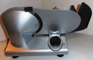 this listing is for a new in box deni electric food slicer model 14150