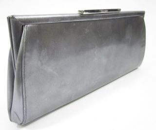 you are bidding on a calvin klein silver patent leather clutch handbag