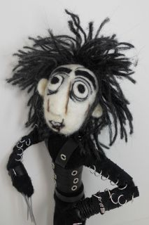 Edwards body is needle felted with core wool over a hand made