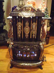 Antq 1895 Cast Iron Gas Parlor Stove Sprites Moon Sun Faces F L Kahn