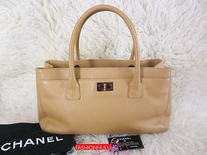 Authentic Chanel Beige Caviar Leather Reissue Cerf Tote Handbag