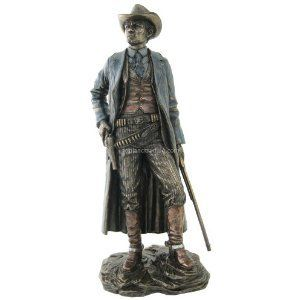 cowboy holding guns material cold cast bronze dimensions h 11