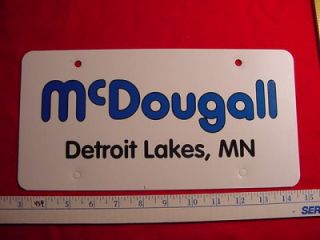 McDougall Detroit Lakes MN Car Dealer Plate Tag Emblem