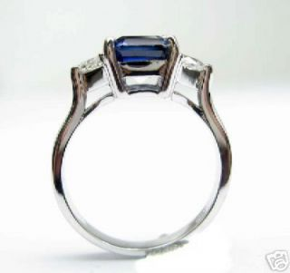 beauty of this emerald cut lab created sapphire engagement ring