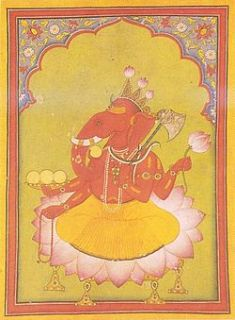 Attired in an orange dhoti, an elephant headed man sits on a large