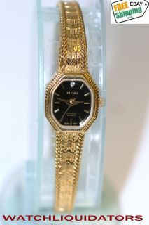 elgin diamond quartz gold tone ladies dress watch black dial with a