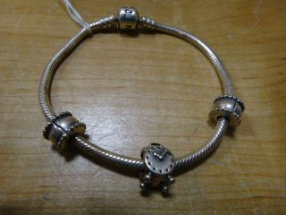 Pandora 7 1 2 Sterling silver Charm Bracelet w 3 Charms Nice Condition