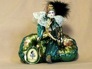 Geppeddo Jester Porcelain Doll Green Gold on Pillow