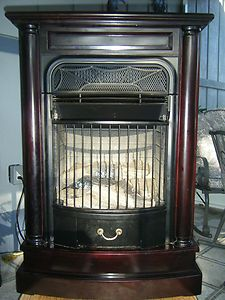 Charmglow Gas Indoor Fireplace / Fan Forced Heater. Solid Wood Cabinet
