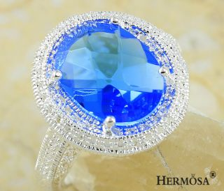 Hermosa Sparkling Charm Oval Paris Blue Topaz Sterling Silver Ring
