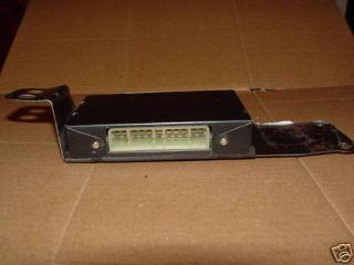 88 89 Mazda 626 Seat Belt Control Box PN GJ2167780A