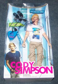 Cody Simpson Autographed White T Shirt and Khaki Pants Doll WCoa