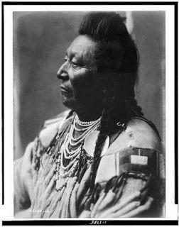Plenty Coups,Crow Indian,pompadour,temple braids,beaded buckskin shirt