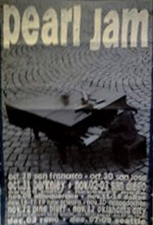 Pearl Jam 1990s tour poster man with piano on street playing in blue