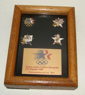 Commemorative Set of 4 Pins Games of the XXlllrd Olympic LA Oak Framed