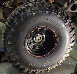 Super Swamper 38 5x11 00x15LT with rims black with red pin strip