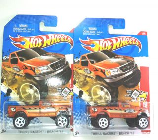 Hot Lot of 2 Ford F 150 2013 Case A Wheels Combined Shipping HotWheels