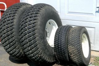 TITAN MULTI TRAC TURF TIRES ON FORD NEW HOLLAND 1725 TRACTOR WHEELS