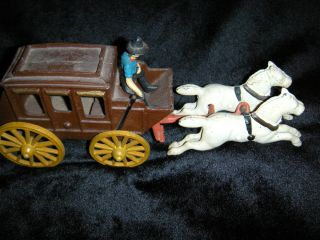 handmade cast iron stage coach & drvier withe horses ,moving wheels